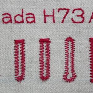 Lada H73A gombíkové dierky, abeceda